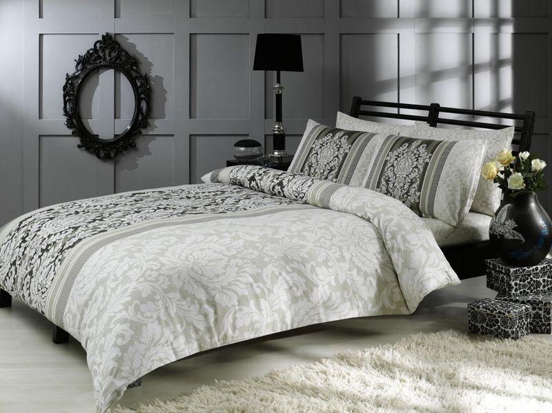 Комплект белья TAC Hazel, семейный, наволочки 50x70, цвет: серый3082-15617Роскошный комплект постельного белья TAC Hazel выполнен из качественного плотного сатина. Комплект состоит из двух пододеяльников, простыни и двух наволочек. Пододеяльник застегивается на пуговицы. Сатин - гладкая и прочная ткань, которая своим блеском, легкостью и гладкостью похожа на шелк, но выгодно отличается от него в цене. Сатин практически не мнется, поэтому его можно не гладить. Ко всему прочему, он весьма практичен, так как хорошо переносит множественные стирки. Доверьте заботу о качестве вашего сна высококачественному натуральному материалу.