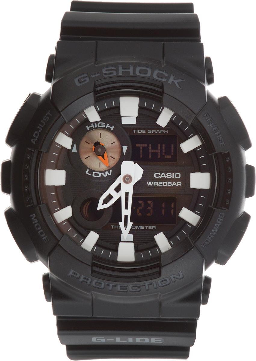 Часы наручные мужские Casio G-Shock, цвет: черный. GAX-100B-1AGAX-100B-1ALED-подсветка при помощи ярких светодиодов циферблата и жидкокристаллического дисплея. Автоматическая подсветка срабатывает при подъеме и повороте руки, а так же при нажатии на кнопку. Датчик термометра, измерение температуры от -10 до +60 °C График приливов с уровнем на определенную дату и время. Отображение мирового времени в 29 часовых поясах зонах с отображением основных городов в них. Секундомер с точностью показаний 1/100 сек и максимальным временем измерения 1000 часов. Таймер обратного отсчета на 60 минут с точностью в 1 секунду. 5 ежедневных будильников, устанавливаемых на определенное время, ежечасный сигнал.. Вкл./Откл. звука кнопок. Автоматическая подстройка положения стрелок пи нажатии кнопок, таким образом, чтобы не закрывать дисплей и вспомогательные индикаторы. Автоматический календарь, не требующий дополнительной корректировки, может быть настроен по 2099 год. Отображение времени в 12/24 часовом формате. Комбинированный корпус выполнен из нержавеющей стали 316L и...
