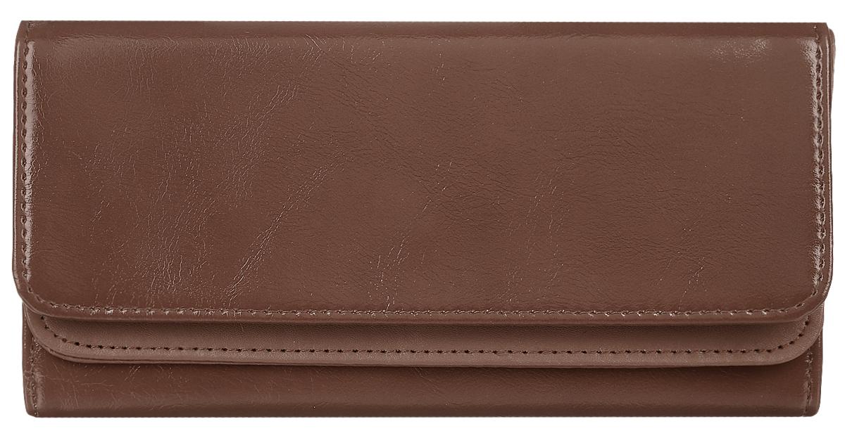 Кошелек женский Leighton, цвет: коричневый. 725725 brownСтильный женский кошелек Leighton выполнен из искусственной кожи и закрывается на кнопку. Подкладка кошелька изготовлена из полиэстера. Изделие содержит три отделения для купюр, один потайной карман, карман для мелочи на молнии, двенадцать карманов для пластиковых карточек.