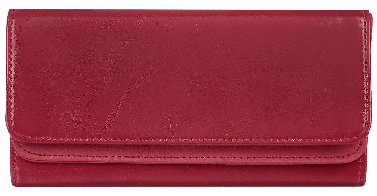 Кошелек женский Leighton, цвет: темно-красный. 725725 bordeauxСтильный женский кошелек Leighton выполнен из искусственной кожи и закрывается на кнопку. Подкладка кошелька изготовлена из полиэстера. Изделие содержит три отделения для купюр, один потайной карман, карман для мелочи на молнии, двенадцать карманов для пластиковых карточек.