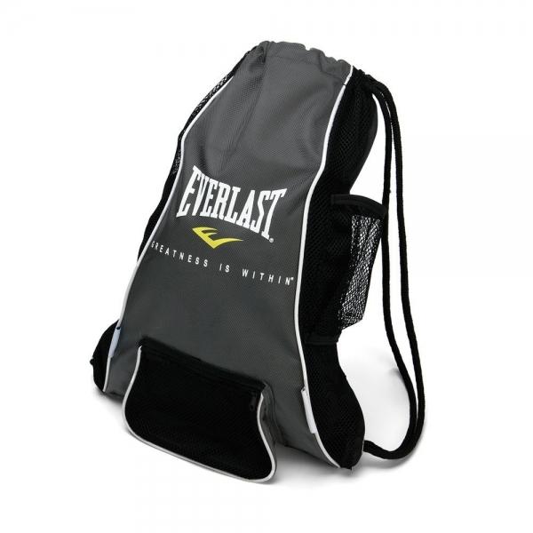 Мешок для боксерских перчаток Everlast Glove, цвет: черный420DEverlast Boxing and Mixed Martial Arts Glove Bag - это небольшая удобная сумка, которая специально разработана для хранения тренировочных перчаток и прочей спортивной экипировки. Антимикробная пропитка EverFresh™ вместе вентиляцией EverCool™ сохранят свежесть ваших вещей, предотвратив появление вредных бактерий и плохого запаха. Небольшой центральный карман прекрасно подходит для хранения скакалок, капы и других мелочей, в то время как боковой карман из сетки позволит без лишних усилий достать бутылочку с водой. Изготовлена из нейлона, горловина сумки затягивается шнуром.