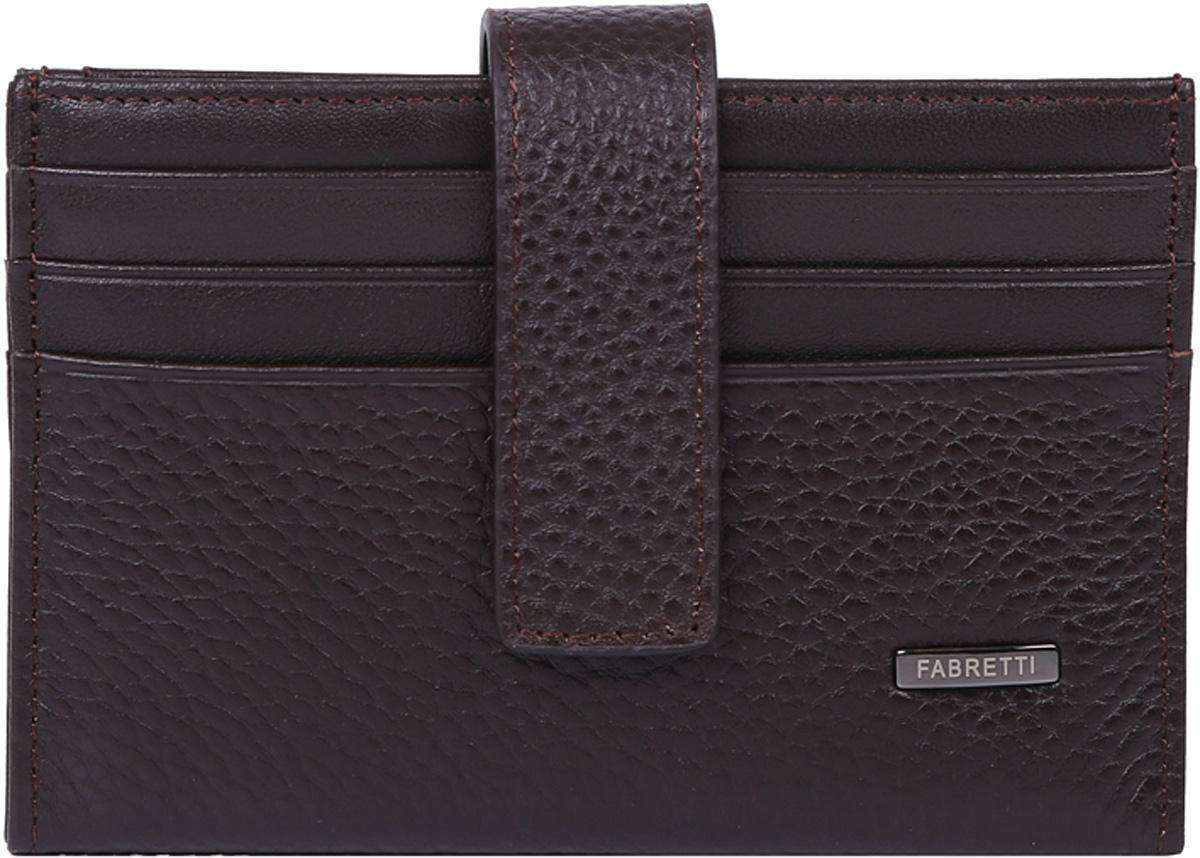 Визитница мужская Fabretti, цвет: коричневый. 46030-coffee46030-coffeeКлассическая визитница от итальянского бренда Fabretti выполнена из натуральной пористой кожи, которая имеет невероятно мягкую и приятную фактуру. С внешней и внутренней стороны модель содержит по 6 отделений, в которых вы сможете расположить свои визитные и дисконтные карточки. Визитница закрывается на прочную застежку.