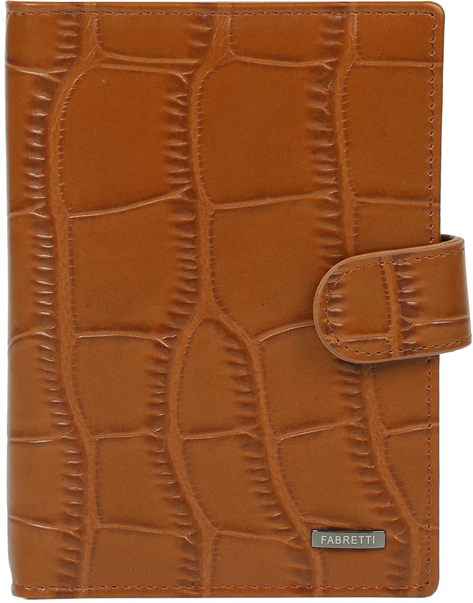 Обложка для документов мужская Fabretti, цвет: коричневый. 53003-tan53003-tanМужская обложка для документов Fabretti выполнена из натуральной кожи с тиснением. Изделие раскладывается пополам и закрывается на хлястик с кнопкой. Обложка содержит съемный блок из шести прозрачных файлов из мягкого пластика, один из которых формата А5, два боковых прозрачных кармана и отделение для паспорта с тремя боковыми карманами и пятью кармашками для пластиковых карт, один из которых с прозрачным окошком.