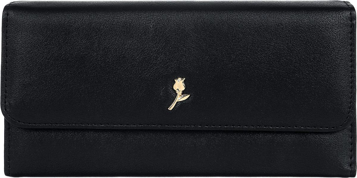 Кошелек женский Leighton, цвет: черный. D-22D-22 blackСтильный женский кошелек Leighton выполнен из искусственной кожи и закрывается на кнопку. Подкладка кошелька изготовлена из полиэстера. Изделие содержит три отделения для купюр, карман для мелочи на молнии, один потайной карман, четыре кармана для пластиковых карт.
