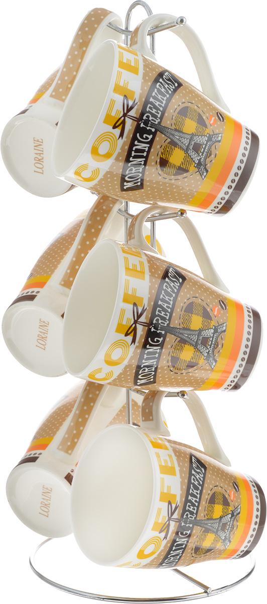 Набор кружек Loraine Modern, на подставке, 390 мл, 7 предметов. 2464124641Набор Loraine состоит из 6 кружек и подставки. Кружки выполнены из высококачественной керамики с глазурованным покрытием. Теплостойкие ручки не позволяют обжечь руки во время чаепития. Для хранения кружек предусмотрена металлическая подставка с удобной ручкой для переноски. Яркий дизайн и качество исполнения сделают такой набор замечательным приобретением для вашей кухни. Можно использовать в микроволновой печи и мыть в посудомоечной машине. Диаметр кружки (по верхнему краю): 8,3 см. Высота кружки: 11 см. Объем кружки: 390 мл. Высота подставки: 38 см.