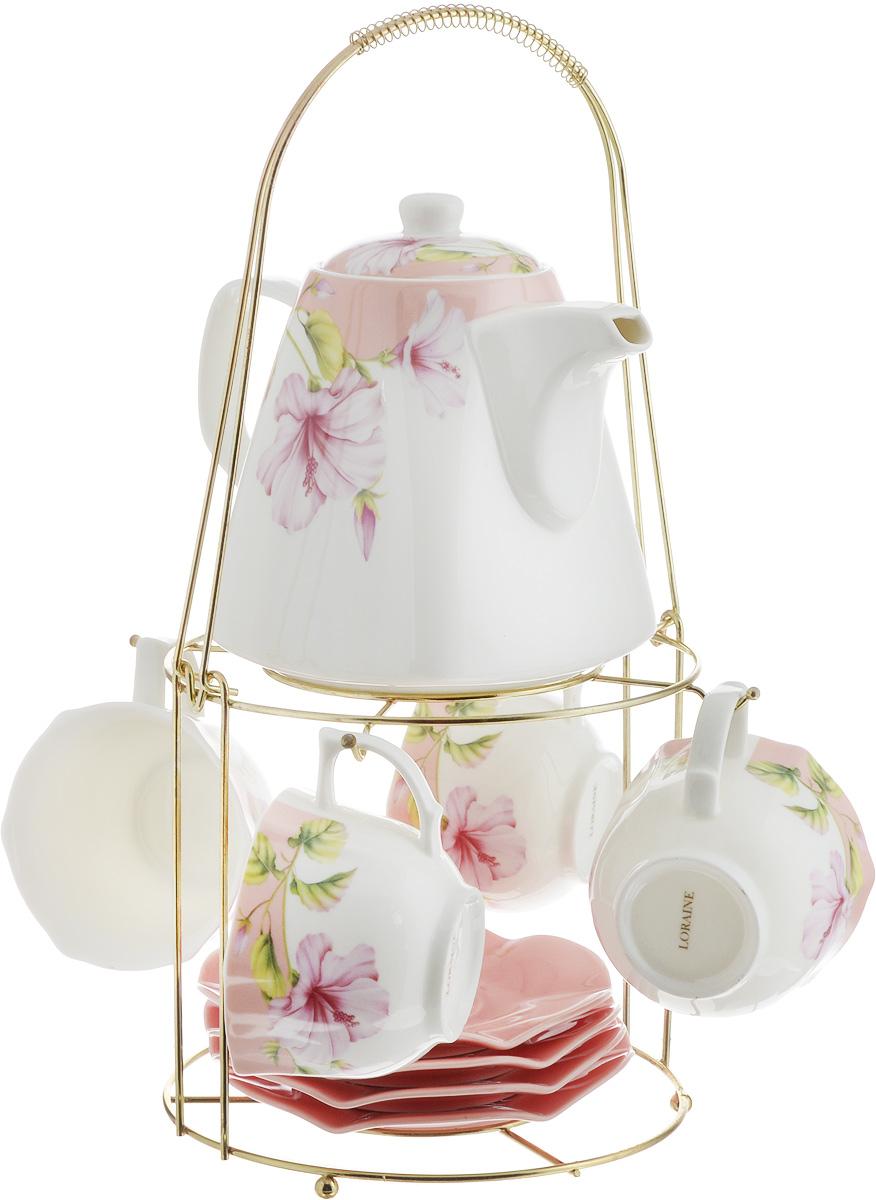 Набор чайный Loraine, на подставке, 10 предметов. 2473724737Чайный набор Loraine состоит из 4 чашек, 4 блюдец, заварочного чайника и подставки. Посуда изготовлена из качественной глазурованной керамики и оформлена изображением цветов. Блюдца и чашки имеют необычную фигурную форму. Все предметы располагаются на удобной металлической подставке с ручкой. Элегантный дизайн набора придется по вкусу и ценителям классики, и тем, кто предпочитает современный стиль. Он настроит на позитивный лад и подарит хорошее настроение с самого утра. Чайный набор Loraine идеально подойдет для сервировки стола и станет отличным подарком к любому празднику. Можно использовать в СВЧ и мыть в посудомоечной машине. Объем чашки: 250 мл. Размеры чашки (по верхнему краю): 8,7 х 9 см. Высота чашки: 6,2 см. Диаметр блюдца: 14 см. Высота блюдца: 1,5 см. Объем чайника: 1,1 л. Размер чайника (без учета ручки и носика): 13 х 13 х 13 см. Размер подставки: 18 х 18 х 37 см.
