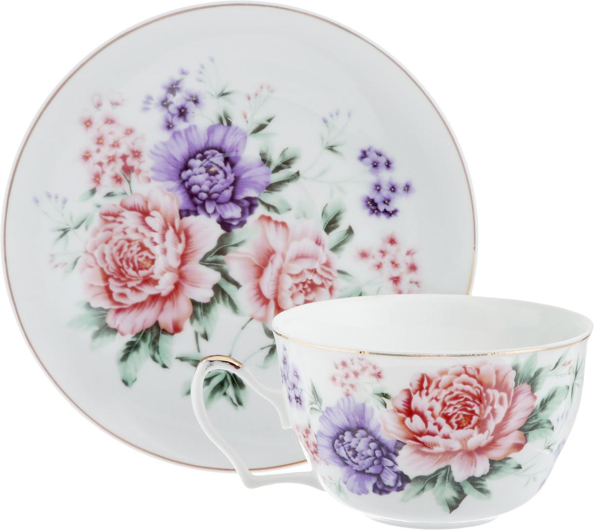Чайная пара Loraine, 2 предмета. 2459524595Чайная пара Loraine состоит из чашки и блюдца. Изделия, выполненные из высококачественной керамики, имеют элегантный дизайн и декорированы изображением цветов. Такая чайная пара прекрасно подойдет как для повседневного использования, так и для праздников. Изящный дизайн и красочность оформления придутся по вкусу и ценителям классики, и тем, кто предпочитает утонченность и изысканность. Чайный пара Loraine - это не только яркий и полезный подарок для родных и близких, это также великолепное дизайнерское решение для вашей кухни или столовой. Объем чашки: 250 мл. Диаметр чашки (по верхнему краю): 9,5 см. Высота чашки: 6 см. Диаметр блюдца: 15 см. Высота блюдца: 2 см.