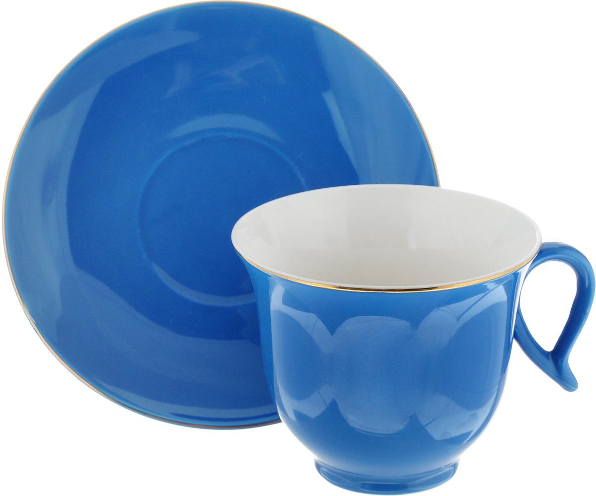 Чайная пара Loraine, цвет: синий, 2 предмета24742Чайная пара Loraine, выполненная из керамики, состоит из 1 чашки и 1 блюдца. Предметы набора имеют яркую расцветку. Изящный дизайн и красочность оформления придутся по вкусу и ценителям классики, и тем, кто предпочитает утонченность и изысканность. Чайная пара - идеальный и необходимый подарок для вашего дома и для ваших друзей в праздники, юбилеи и торжества! Он также станет отличным корпоративным подарком и украшением любой кухни. Чайная пара упакована в подарочную коробку из плотного цветного картона. Внутренняя часть коробки задрапирована белым атласом. Диаметр чашки (по верхнему краю): 9,2 см. Высота чашки: 7,5 см. Объем чашки: 220 мл. Диаметр блюдца: 14,5 см. Высота блюдца: 2 см.