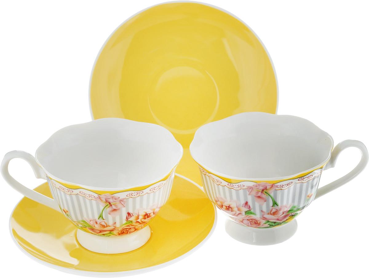 Набор чайный Loraine Садовые розы, цвет: желтый, серый, зеленый, 4 предмета. 2300123001Чайный набор Loraine Садовые розы, выполненный из керамики, состоит из 2 чашек и 2 блюдец. Предметы набора имеют яркую расцветку. Изящный дизайн и красочность оформления придутся по вкусу и ценителям классики, и тем, кто предпочитает современный стиль. Чайный набор - идеальный и необходимый подарок для вашего дома и для ваших друзей в праздники, юбилеи и торжества! Он также станет отличным корпоративным подарком и украшением любой кухни. Чайный набор упакован в подарочную коробку из плотного цветного картона. Внутренняя часть коробки задрапирована белым атласом. Размер кружки (по верхнему краю): 9,5 х 9 см. Высота стенки: 6,5 см. Диаметр блюдца: 14,2 см. Высота блюдца: 2 см. Объем чашки: 200 см.