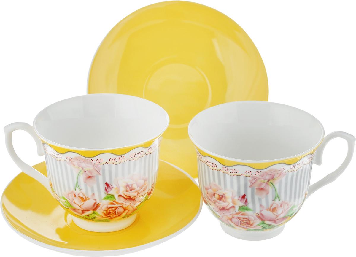 Набор чайный Loraine Садовые розы, цвет: желтый, серый, зеленый, 4 предмета. 2298922989Чайный набор Loraine Садовые розы, выполненный из керамики, состоит из 2 чашек и 2 блюдец. Предметы набора имеют яркую расцветку. Изящный дизайн и красочность оформления придутся по вкусу и ценителям классики, и тем, кто предпочитает современный стиль. Чайный набор - идеальный и необходимый подарок для вашего дома и для ваших друзей в праздники, юбилеи и торжества! Он также станет отличным корпоративным подарком и украшением любой кухни. Чайный набор упакован в подарочную коробку из плотного цветного картона. Внутренняя часть коробки задрапирована белым атласом. Диаметр кружки (по верхнему краю): 9,3 см. Высота стенки: 7,4 см. Диаметр блюдца: 14,2 см. Высота блюдца: 2 см. Объем чашки: 220 см.