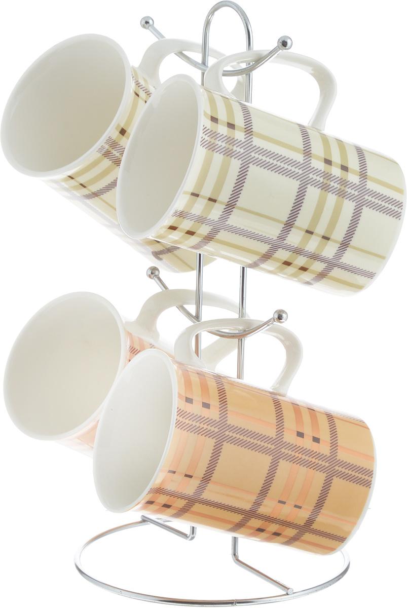 Набор кружек Loraine, на подставке, 5 предметов. 2420724207Набор Loraine состоит из 4 кружек и подставки. Кружки изготовлены из глазурованной керамики и украшены узором клетка. Теплостойкие ручки обеспечивают комфортное использование. Кружки подходят для горячих и холодных напитков. Изящный дизайн придется по вкусу и ценителям классики, и тем, кто предпочитает современный стиль. Он настроит на позитивный лад и подарит хорошее настроение с самого утра. В комплекте - металлическая подставка с крючками для подвешивания кружек. Набор кружек - идеальный и необходимый подарок для вашего дома и для ваших друзей на праздники, юбилеи и торжества. Кружки подходят для мытья в посудомоечной машине, можно использовать в СВЧ и ставить в холодильник. Объем кружек: 320 мл. Диаметр кружки (по верхнему краю): 7,5 см. Высота кружки: 11 см. Размер подставки: 13 х 13 х 26,5 см.