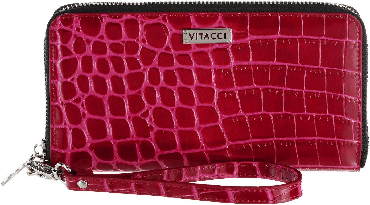 Кошелек женский Vitacci, цвет: розовый, красный. HS134HS134Элегантный женский кошелек Vitacci выполнен из высококачественной натуральной кожи с тиснением под крокодила. Кошелек застегивается на застежку-молнию и имеет три отделения для купюр и средник на молнии. Внутри также располагаются двенадцать накладных открытых кармашков для карт и два больших накладных кармашка для бумаг и документов. Модель дополнена съемным ремешком на запястье. Практичность и уникальный стиль кошелька Vitacci подчеркнут вашу элегантность и превосходный вкус.