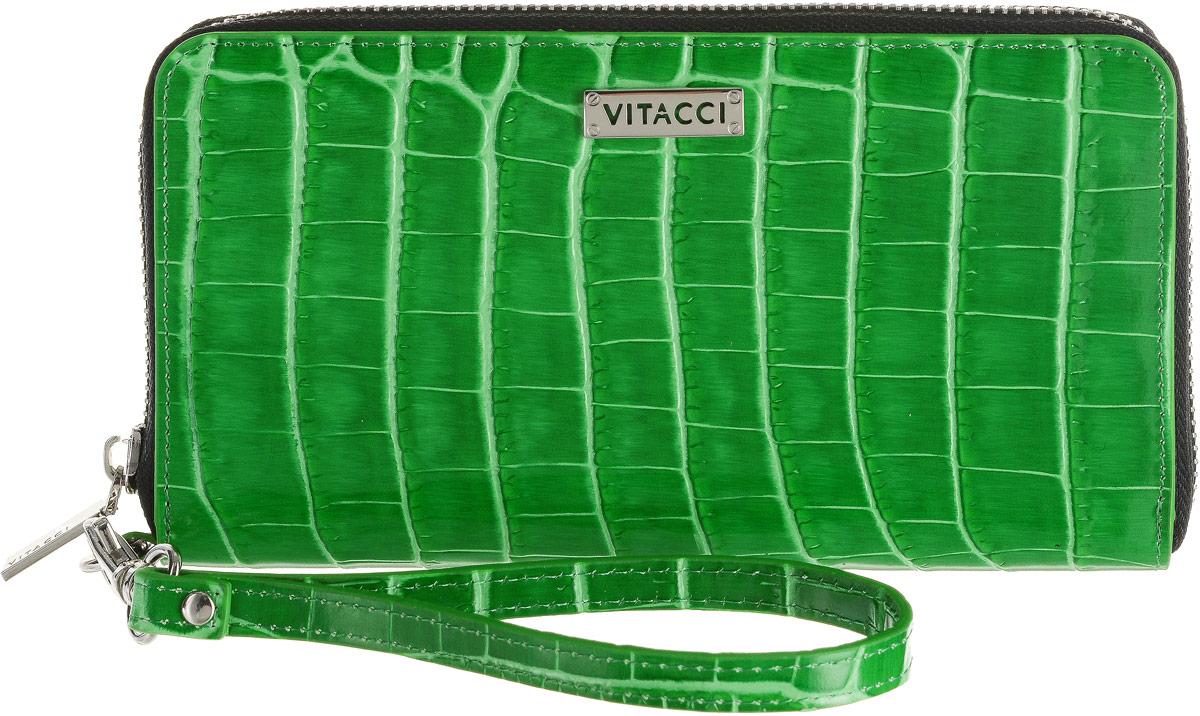 Кошелек женский Vitacci, цвет: зеленый. HS151HS151Элегантный женский кошелек Vitacci выполнен из высококачественной натуральной кожи с тиснением под крокодила. Кошелек застегивается на застежку-молнию и имеет три отделения для купюр со средником на молнии. Внутри также располагаются двенадцать накладных открытых кармашков для карт и два больших накладных кармашка для бумаг и документов. Модель дополнена съемным ремешком на запястье. Практичность и уникальный стиль кошелька Vitacci подчеркнут вашу элегантность и превосходный вкус.