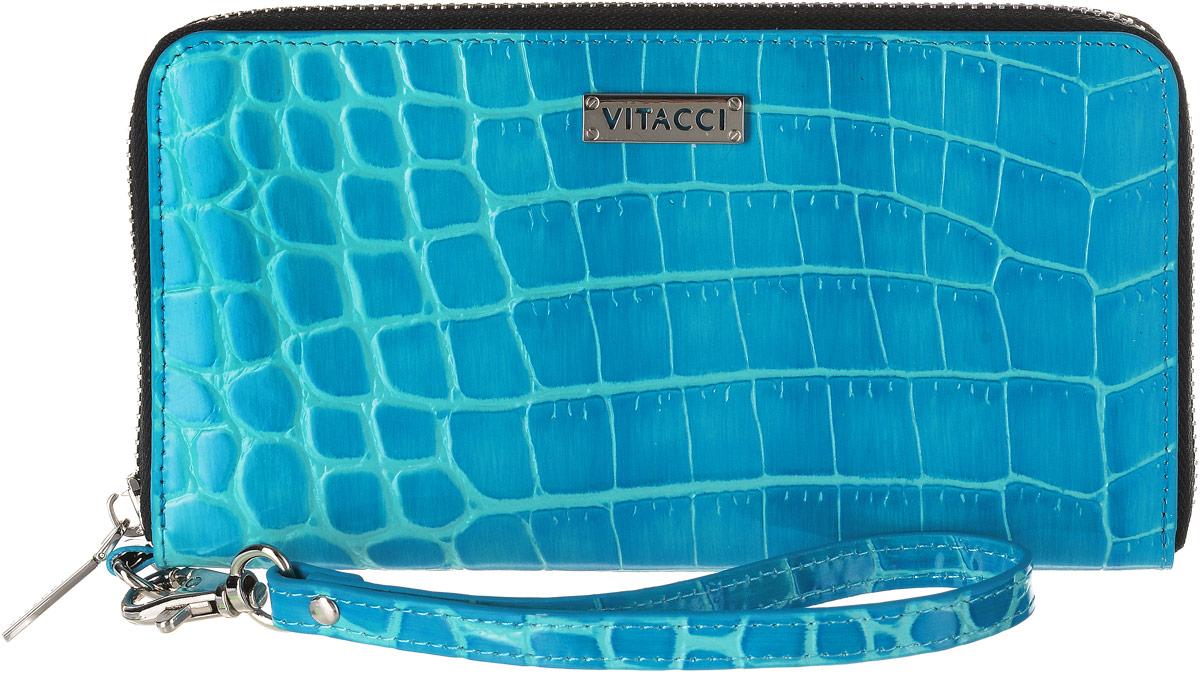 Кошелек женский Vitacci, цвет: голубой. HS133HS133Элегантный женский кошелек Vitacci выполнен из высококачественной натуральной кожи с тиснением под крокодила. Кошелек застегивается на застежку-молнию и имеет три отделения для купюр со средником на молнии. Внутри также располагаются двенадцать накладных открытых кармашков для карт и два больших накладных кармашка для бумаг и документов. Модель дополнена съемным ремешком на запястье. Практичность и уникальный стиль кошелька Vitacci подчеркнут вашу элегантность и превосходный вкус.