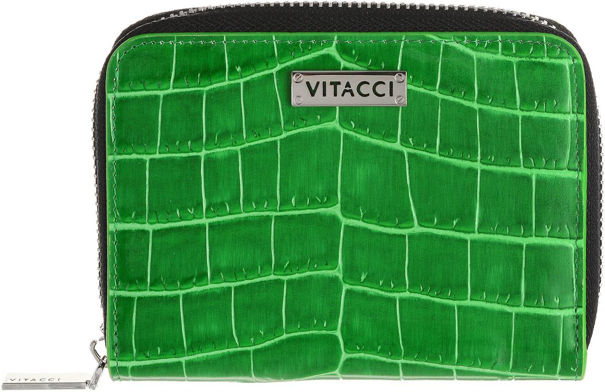 Кошелек женский Vitacci, цвет: зеленый. HS137HS137Элегантный женский кошелек Vitacci выполнен из высококачественной натуральной кожи с тиснением под крокодила. Кошелек застегивается на застежку-молнию и имеет два отделения для купюр. Внутри также располагаются семь накладных открытых кармашков для карт, один из которых дополнен прозрачной вставкой. На задней стенке кошелька находится прорезной карман для мелочи на застежке-молнии. Практичность и уникальный стиль кошелька Vitacci подчеркнут вашу элегантность и превосходный вкус.