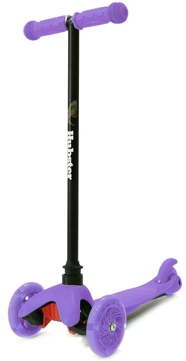 Самокат Hubster Mini Flash, цвет: фиолетовый2246Светящиеся колеса! Высота руля от пола мин/макс: 64 см. Ширина руля: 25 см. Ширина деки: 11 см. Длина деки: 36 см. Размер колес: 120 мм. Максимальная нагрузка: 25 кг. Подшипники: ABEC7. Вес: 1,6 кг.