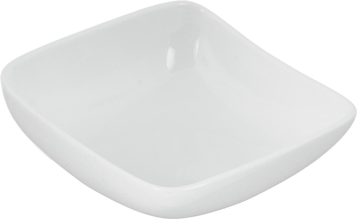 Салатник Ariane Vital Square, 150 млAVSARN22010Салатник Ariane Vital Square, изготовленный из высококачественного фарфора с глазурованным покрытием, прекрасно подойдет для подачи различных блюд: закусок, салатов или фруктов. Такой салатник украсит ваш праздничный или обеденный стол. Можно мыть в посудомоечной машине и использовать в микроволновой печи. Размер салатника (по верхнему краю): 10,5 х 10,5 см. Высота: 4,5 см. Объем салатника: 150 мл.