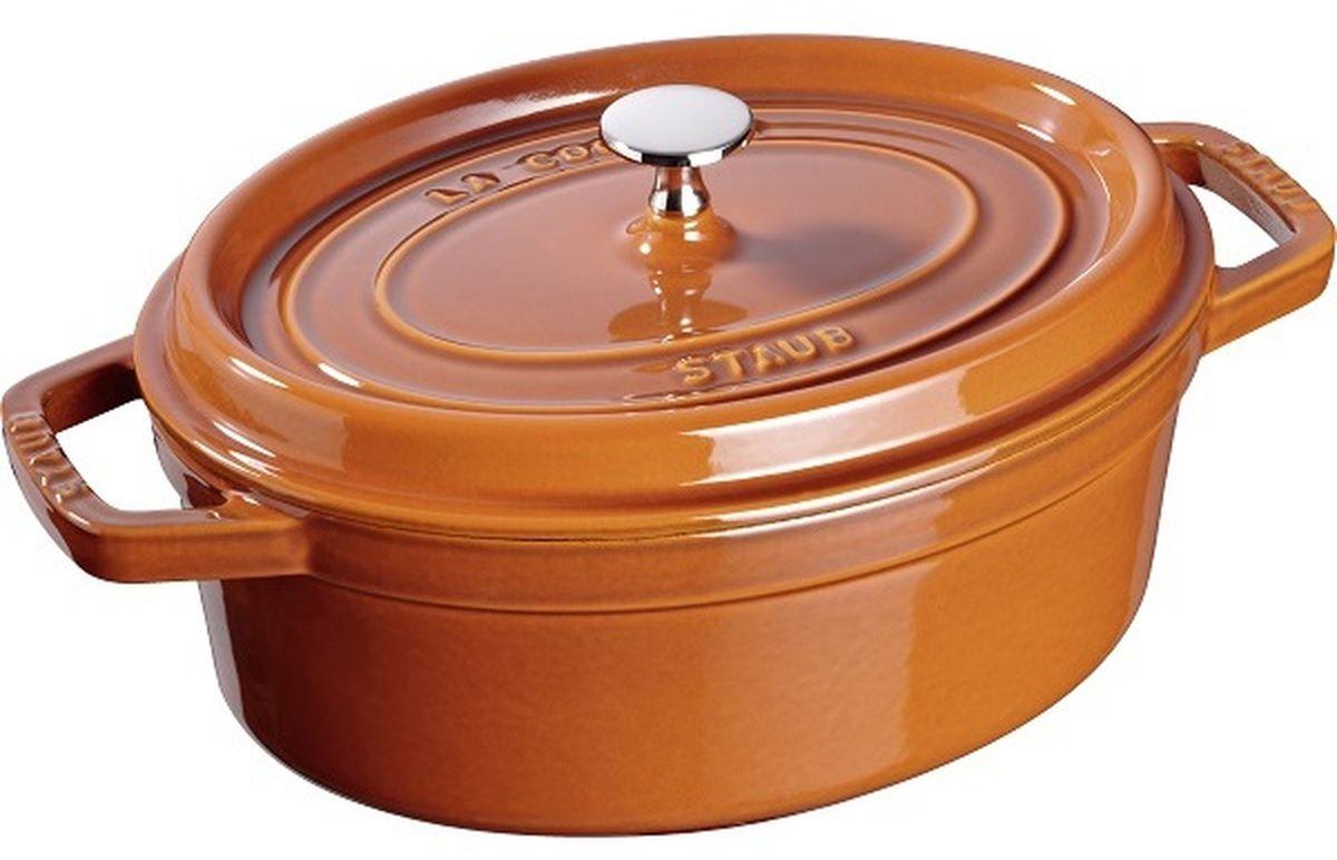 Кокот Staub, овальный, цвет: коричневый, 4,2 л11029806Изготовлен из чугуна, покрытого эмалью снаружи и внутри. Подходит для использования на всех типах плит и в духовке. Перед первым использованием снять этикетки, тщательно вымыть горячей водой с мыльным средством и высушить, затем нанести немного растительного масла на внутреннюю поверхность посуды, излишки масла удалить салфеткой. Мыть жидким моющим средством, без применения абразивных веществ и металлических губок. Пригоден для мытья в посудомоечной машине. При падении на твердую поверхность посуда может треснуть или разбиться. Металлические кухонные принадлежности могут повредить посуду. Избегать резкого нагревания и охлаждения, резкий перепад температуры может привести к повреждению посуды. Чтобы не обжечься, пользуйтесь прихватками.Адрес изготовителя:Zwilling Staub France S.A.S, 47 bis, rue des Vinaigriers, 75010 Paris, FRANCE (Цвиллинг Стауб Франс С.А.С 47 бис, ру де Винаигриерс, 75010 Париж, Франция)
