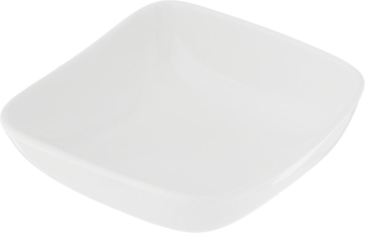 Салатник Ariane Vital Square, 220 млAVSARN22012Салатник Ariane Vital Square, изготовленный из высококачественного фарфора с глазурованным покрытием, прекрасно подойдет для подачи различных блюд: закусок, салатов или фруктов. Такой салатник украсит ваш праздничный или обеденный стол. Можно мыть в посудомоечной машине и использовать в микроволновой печи. Размер салатника (по верхнему краю): 12 х 12 см. Высота стенки: 4,5 см. Объем салатника: 220 мл.