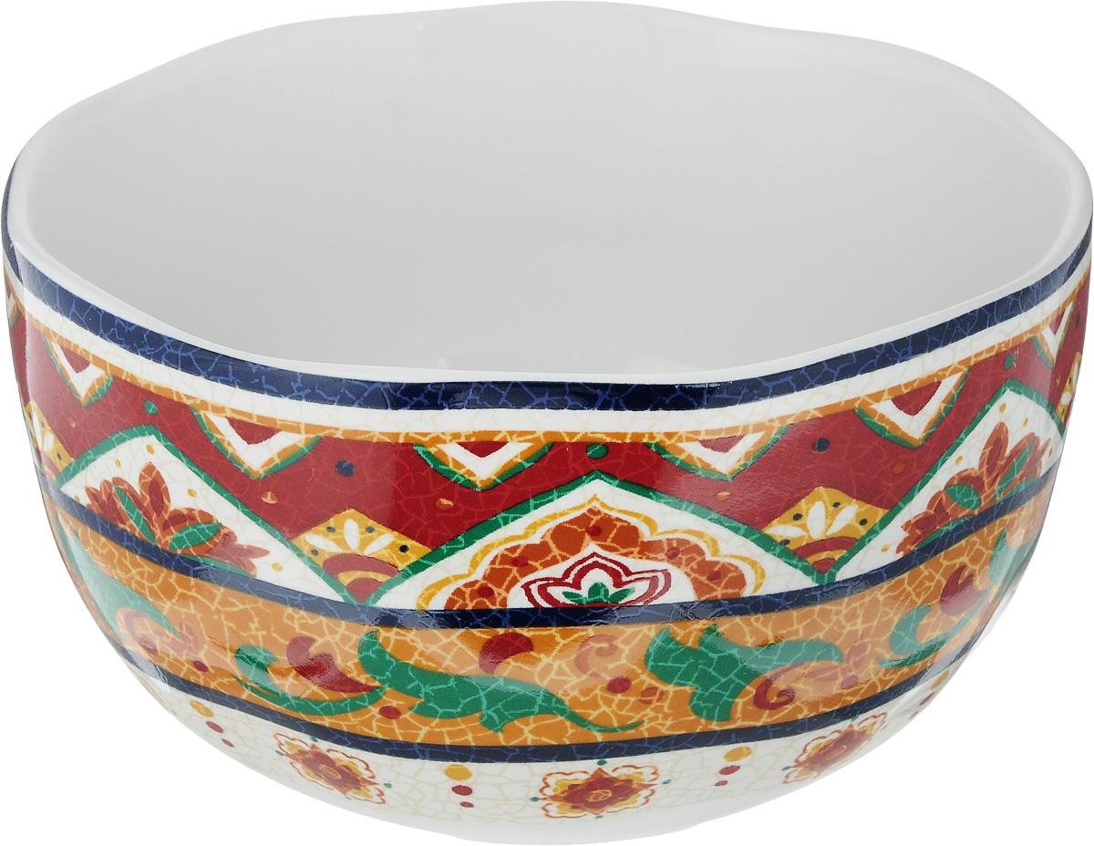 Салатник Sango Ceramics Мессина, диаметр 15 смUTMS41640Салатник Sango Ceramics Мессина, изготовленный из высококачественного фарфора с глазурованным покрытием, прекрасно подойдет для подачи различных блюд: закусок, салатов или фруктов. Такой салатник украсит ваш праздничный или обеденный стол. Можно мыть в посудомоечной машине и использовать в микроволновой печи. Диаметр салатника (по верхнему краю): 15 см. Диаметр основания: 8,5 см. Высота стенки: 8 см.