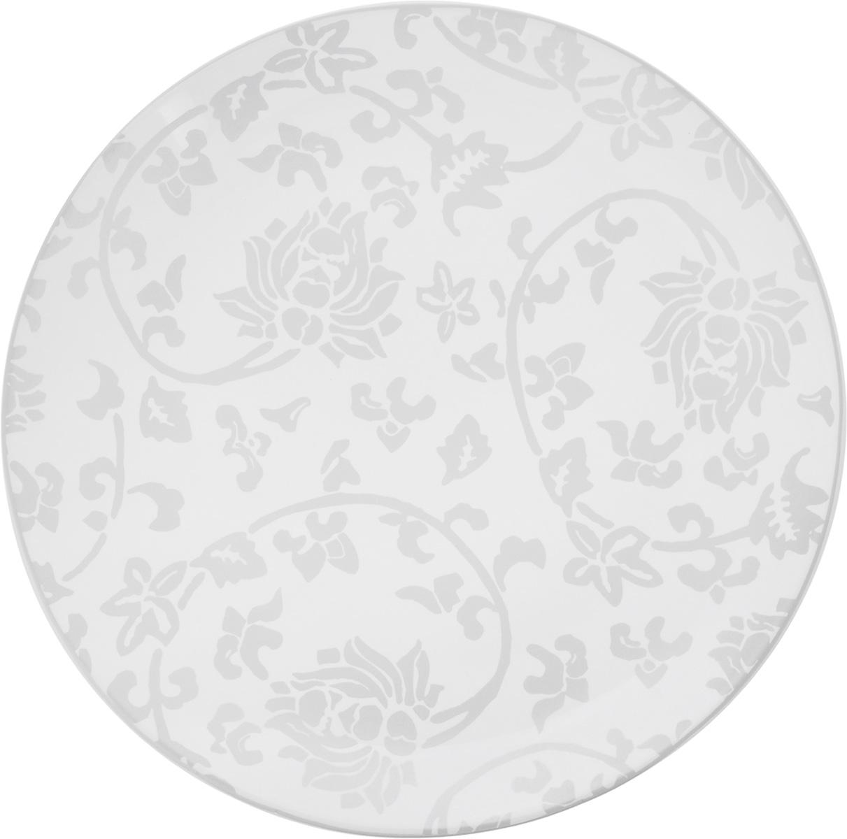 Тарелка обеденная Sango Ceramics Джапан Деним Сильвер, диаметр 26,5 смUTJDS36110Обеденная тарелка Sango Ceramics Джапан Деним Сильвер, изготовленная из высококачественной керамики, имеет изысканный внешний вид. Она идеально подходит для красивой сервировки стола. Изделие прекрасно впишется в интерьер вашей кухни и станет достойным дополнением к кухонному инвентарю. Тарелка Sango Ceramics Джапан Деним Сильвер подчеркнет прекрасный вкус хозяйки и станет отличным подарком. Можно мыть в посудомоечной машине и использовать в микроволновой печи. Диаметр тарелки (по верхнему краю): 26,5 см. Высота тарелки: 3 см.
