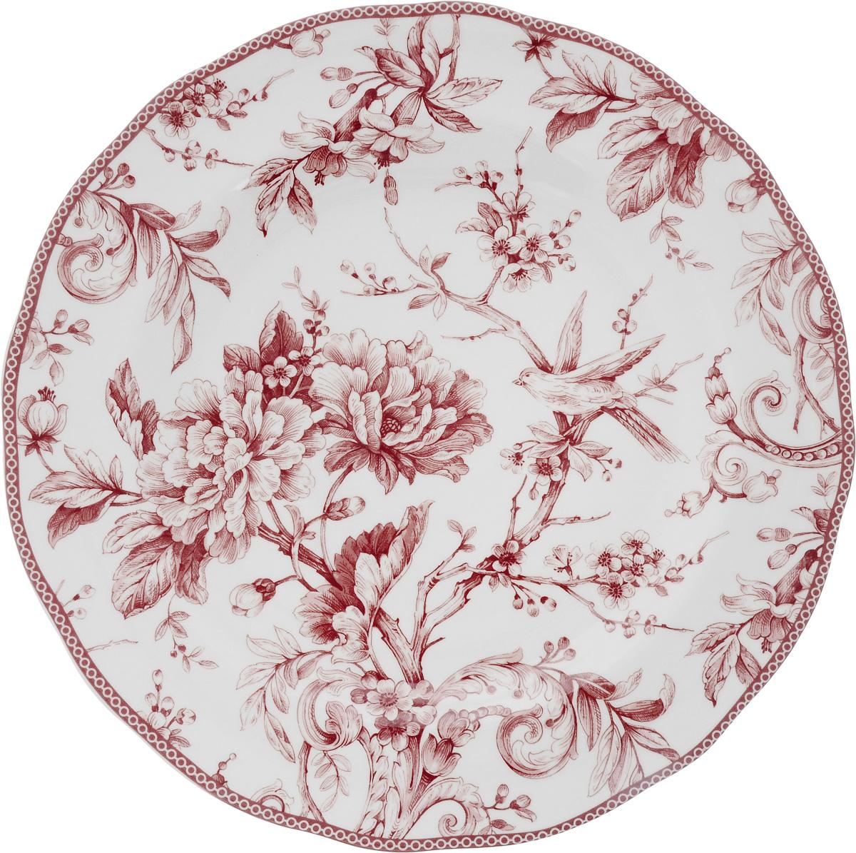 Блюдо Sango Ceramics Аделаида Бордо, диаметр 33 смUTAB97310Круглое блюдо Sango Ceramics Аделаида Бордо, изготовленное из керамики, прекрасно подойдет для подачи нарезок, закусок и других блюд. Изделие, оформленное оригинальным рисунком, украсит сервировку вашего стола и подчеркнет прекрасный вкус хозяйки. Можно мыть в посудомоечной машине и использовать в микроволновой печи. Диаметр блюда (по верхнему краю): 33 см. Высота блюда: 4 см.