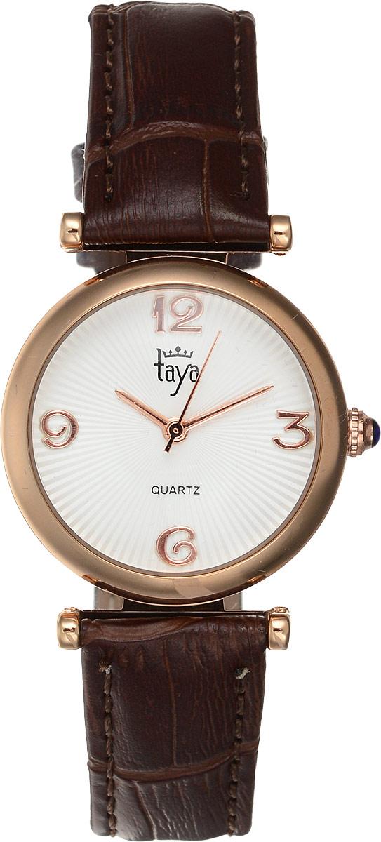 Часы наручные женские Taya, цвет: золотистый, коричневый. T-W-0003T-W-0003-WATCH-GL.BROWNЭлегантные женские часы Taya выполнены из минерального стекла, натуральной кожи и нержавеющей стали. Циферблат инкрустирован стразами и дополнен символикой бренда. Корпус часов оснащен кварцевым механизмом со сменным элементом питания, а также дополнен ремешком из натуральной кожи, который застегивается на пряжку. Ремешок декорирован тиснением под кожу рептилии. Часы поставляются в фирменной упаковке. Часы Taya подчеркнут изящность женской руки и отменное чувство стиля у их обладательницы.