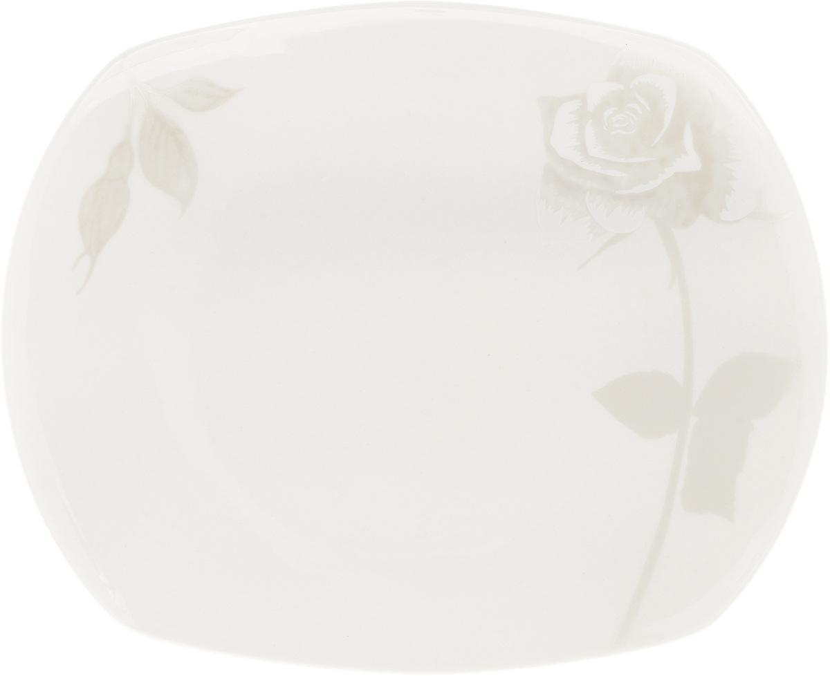 Блюдо Жемчужная роза, 22,5 x 18,5 см216698Оригинальное блюдо Жемчужная роза, изготовленное из фарфора с глазурованным покрытием, прекрасно подойдет для подачи нарезок, закусок и других блюд. Оно украсит ваш кухонный стол, а также станет замечательным подарком к любому празднику. Размер блюда: 22,5 x 18,5 см.