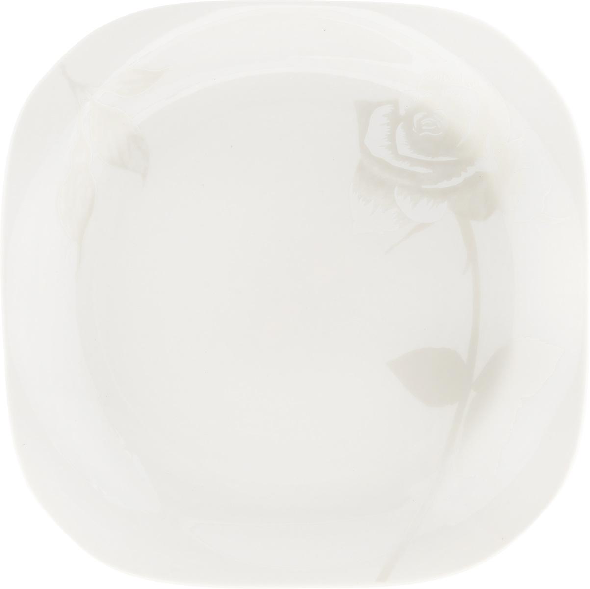 Тарелка десертная Жемчужная роза, 18 x 18 см216693Десертная тарелка Жемчужная роза изготовлена из глазурованного фарфора. Она предназначена для подачи десертов. Также может использоваться как блюдо для сервировки закусок. Изящная тарелка прекрасно оформит стол и порадует ваших гостей изысканным дизайном и формой. Размер тарелки: 18 х 18 см.