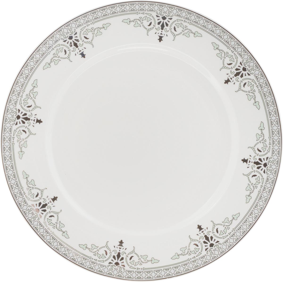 Тарелка подстановочная Венеция, диаметр 27 см216687Тарелка Венеция изготовлена из глазурованного фарфора. Подстановочная тарелка - это особый вид тарелок. Обычно она выполняет исключительно декоративную функцию. Такая тарелка изысканно украсит сервировку как обеденного, так и праздничного стола. Диаметр тарелки: 27 см.