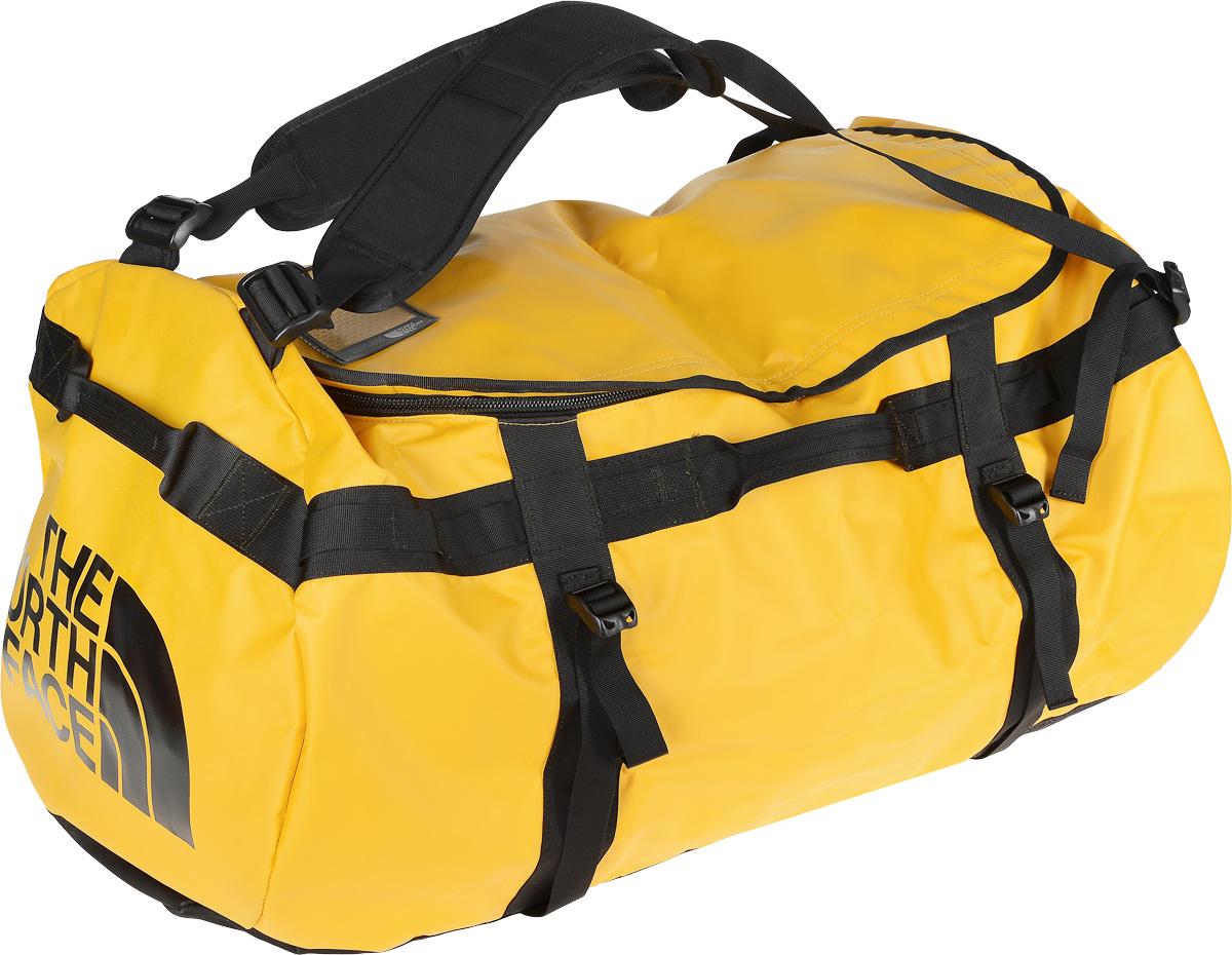 Сумка-рюкзак The North Face, цвет: желтый, 132 л. CWV7_ZU3T0CWV7ZU3Удобная экспедиционная сумка-рюкзак The North Face, вместительная модель, которая подойдет на любой жизненный случай. Изготовлена модель из сочетания водонепроницаемого баллистического нейлона и полиэстера с TPE ламинированием. Корпус изделия укреплен поперечными лентами с двойной отстрочкой и по бокам четырьмя лентами для утяжки. Модель имеет улучшенные эргономичные плечевые лямки, новые укрепленные боковые ручки, которые позволяют с удобством переносить или тащить тяжелые грузы. Основное отделение сумки застегивается на U-образную молнию с защитой от влаги. Верхняя крышка сумки дополнена небольшим отделением для бейджа с персональными данными, а с внутренней стороны имеет карман на молнии из сетчатой ткани. С внутренней стороны сумка дополнена накладным открытым карманом из сетчатой ткани. Оформлена модель износостойким принтом с логотипом бренда.
