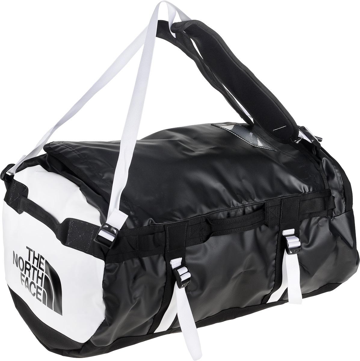 Сумка-рюкзак The North Face, цвет: белый, черный, 71 л. CWW2_ZU3T0CWW2ZU3Удобная экспедиционная сумка-рюкзак The North Face, вместительная модель, которая подойдет на любой жизненный случай. Изготовлена модель из сочетания водонепроницаемого баллистического нейлона и полиэстера с TPE ламинированием. Корпус изделия укреплен поперечными лентами с двойной отстрочкой и по бокам четырьмя лентами для утяжки. Модель имеет улучшенные эргономичные плечевые лямки, новые укрепленные боковые ручки, которые позволяют с удобством переносить или тащить тяжелые грузы. Основное отделение сумки застегивается на U-образную молнию с защитой от влаги. Также изделие оснащено дополнительным боковым карманом на молнии. Верхняя крышка сумки дополнена небольшим отделением для бейджа с персональными данными, а с внутренней стороны имеет карман на молнии из сетчатой ткани. Оформлена модель износостойким принтом с логотипом бренда.