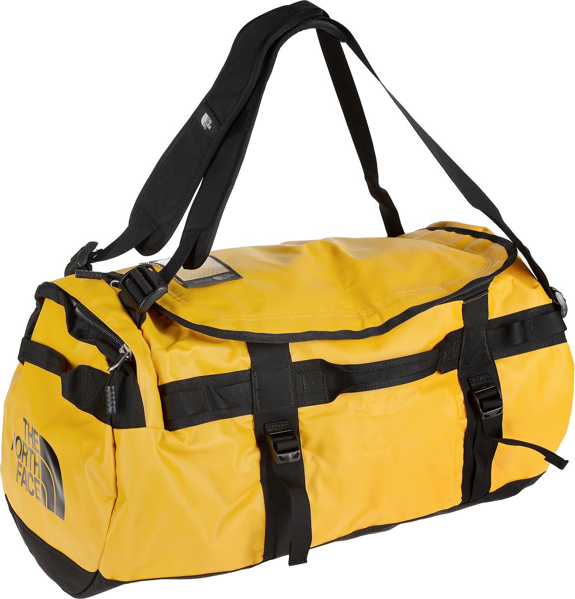 Сумка-рюкзак The North Face, цвет: желтый, черный, 71 л. CWW2_KY4T0CWW2KY4Удобная экспедиционная сумка-рюкзак The North Face, вместительная модель, которая подойдет на любой жизненный случай. Изготовлена модель из сочетания водонепроницаемого баллистического нейлона и полиэстера с TPE ламинированием. Корпус изделия укреплен поперечными лентами с двойной отстрочкой и по бокам четырьмя лентами для утяжки. Модель имеет улучшенные эргономичные плечевые лямки, новые укрепленные боковые ручки, которые позволяют с удобством переносить или тащить тяжелые грузы. Основное отделение сумки застегивается на U-образную молнию с защитой от влаги. Также изделие оснащено дополнительным боковым карманом на молнии. Верхняя крышка сумки дополнена небольшим отделением для бейджа с персональными данными, а с внутренней стороны имеет карман на молнии из сетчатой ткани. Оформлена модель износостойким принтом с логотипом бренда.