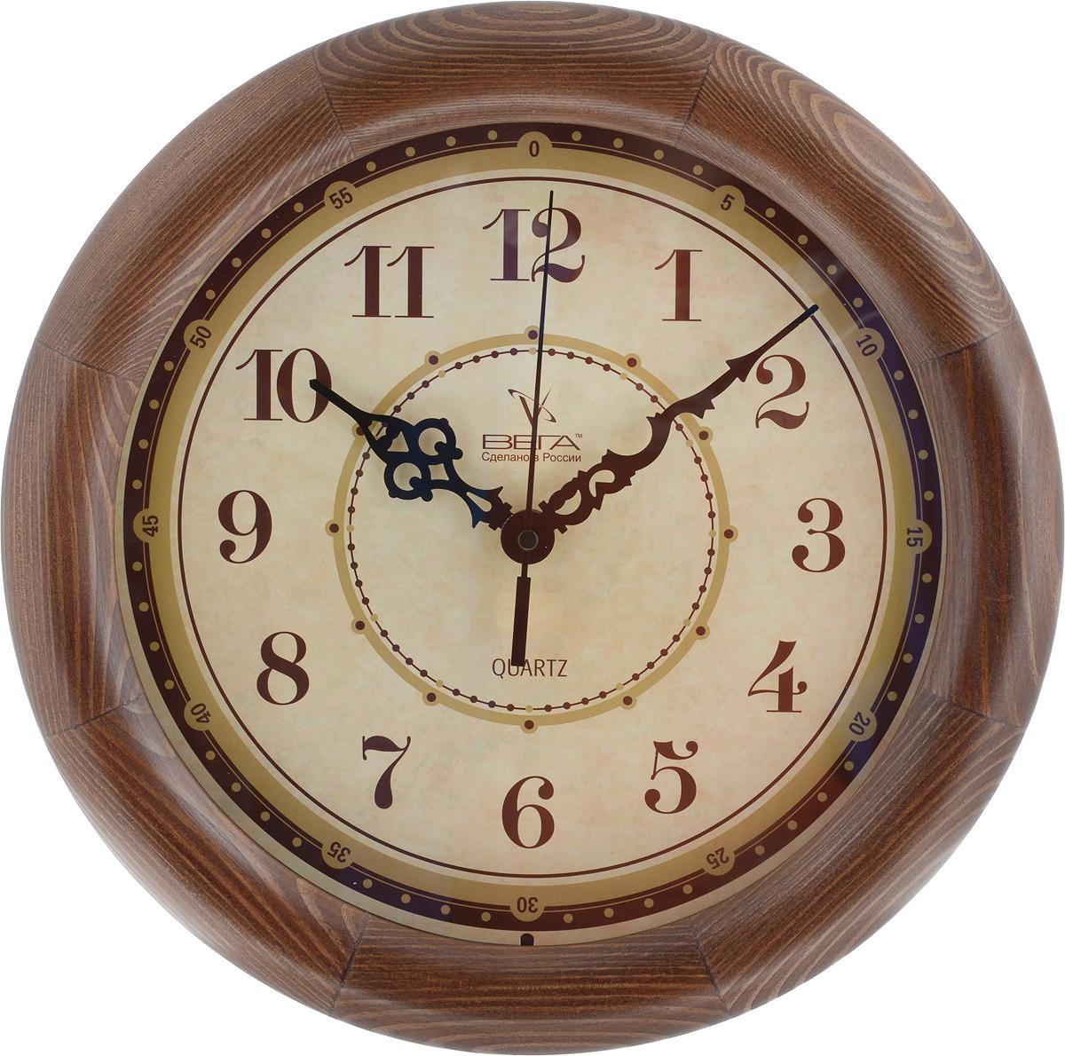 Часы настенные Вега Классика, цвет: темно-коричневый, диаметр 30 смД1МД/6-191Настенные кварцевые часы Вега Классика, изготовленные из дерева, прекрасно впишутся в интерьер вашего дома. Часы имеют три стрелки: часовую, минутную и секундную, циферблат защищен прозрачным стеклом. Часы работают от 1 батарейки типа АА напряжением 1,5 В (не входит в комплект). Диаметр часов: 30 см.