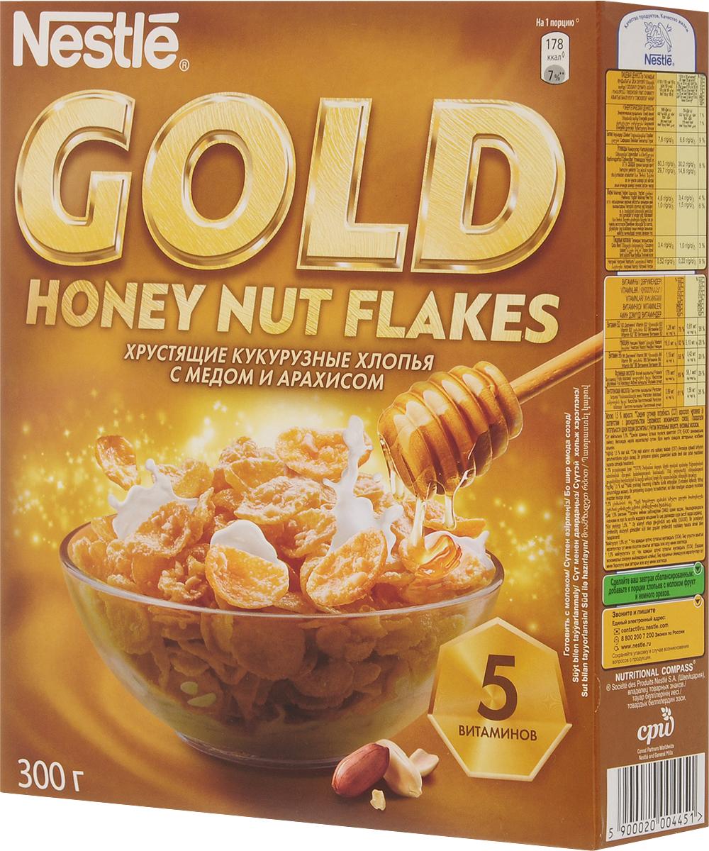 Nestle Gold Honey Nut Flakes готовый завтрак, 300 г12254821Готовый завтрак Nestle Gold Honey Nut Flakes - это отличный завтрак для всей семьи. Хрустящие кукурузные хлопья с медом и арахисом дополнительно обогащены комплексом витаминов. Каждая порция готового завтрака более чем на 15% удовлетворяет рекомендуемую суточную потребность в витаминах B2, B3 (ниацине), B5 (пантотеновой кислоте), B6 и B9 (фолиевой кислоте). Вы любите начинать утро с полезного, качественного и вкусного завтрака? Вы привыкли выбирать для себя только самое лучшее? Тогда кукурузные хлопья с медом и арахисом Gold Honey Nut Flakes - для вас! Хлопья рекомендуется употреблять с молоком, кефиром, йогуртом или соком. Уважаемые клиенты! Обращаем ваше внимание на то, что упаковка может иметь несколько видов дизайна. Поставка осуществляется в зависимости от наличия на складе.