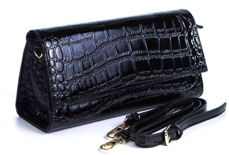 Сумка женская Milana, цвет: черный. 162663-1-710162663-1-710Удобная женская сумка Milana изготовлена из искусственной кожи. Внутренняя подкладка выполнена из искусственного шелка. Сумка закрывается на магнитный замок. Внутри имеется одно основное отделение. Модель оснащена наплечным съемным ремешком, а также сумку можно носить как клатч в руке. Оригинальный аксессуар позволит вам завершить образ и быть неотразимой.