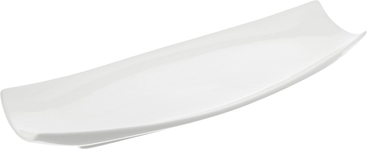 Блюдо Wilmax, 40 х 13 смWL-992624 / AОригинальное прямоугольное блюдо Wilmax, изготовленное из фарфора с глазурованным покрытием, прекрасно подойдет для подачи нарезок, закусок и других блюд. Фарфор от Wilmax изготовлен по уникальному рецепту из сплава магния и алюминия, благодаря чему посуда обладает характерной белизной, прочностью и устойчивостью к сколами. Блюдо украсит ваш кухонный стол, а также станет замечательным подарком к любому празднику. Можно мыть в посудомоечной машине и использовать в микроволновой печи.