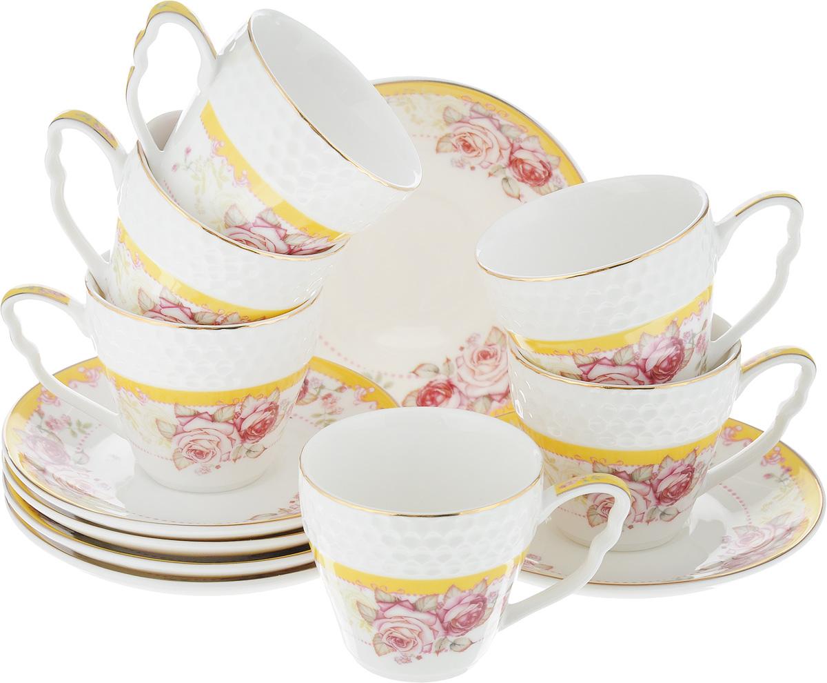 Набор кофейный Loraine Розы, 12 предметов. 2578825788Кофейный набор Loraine Розы состоит из 6 чашек и 6 блюдец. Изделия выполнены из высококачественного костяного фарфора, оформлены золотистой каймой и цветочным рисунком. Такой набор станет прекрасным украшением стола и порадует гостей изысканным дизайном и утонченностью. Набор упакован в подарочную коробку, задрапированную внутри белой атласной тканью. Каждый предмет надежно зафиксирован внутри коробки. Кофейный набор Loraine Розы идеально впишется в любой интерьер, а также станет идеальным подарком для ваших родных и близких. Объем чашки: 90 мл. Диаметр чашки (по верхнему краю): 6,2 см. Высота чашки: 5,5 см. Диаметр блюдца (по верхнему краю): 11,2 см. Высота блюдца: 1,5 см.