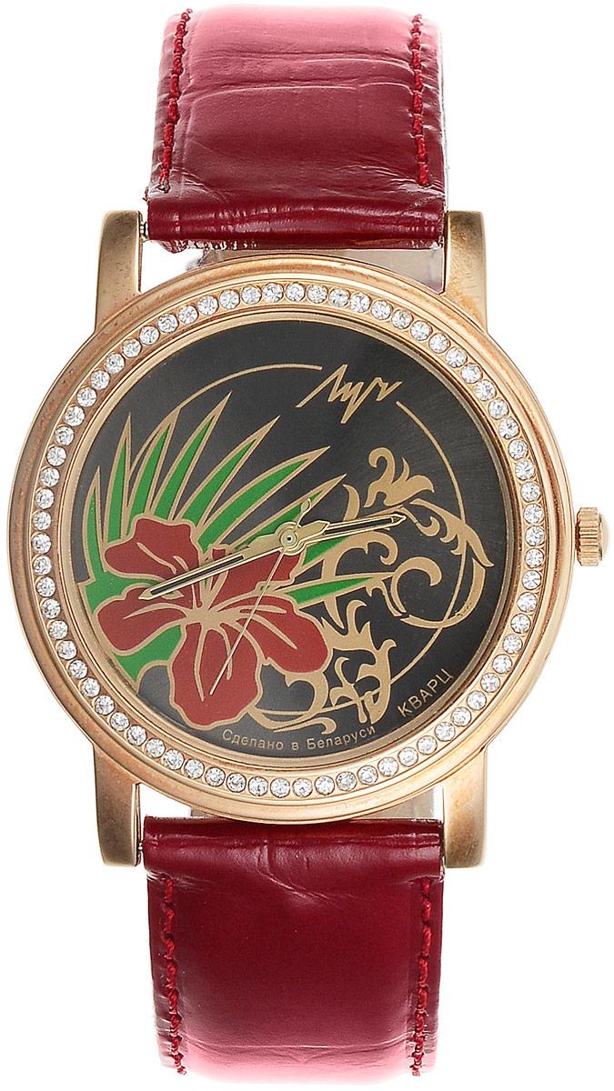 Наручные часы женские Луч, цвет: бордовый, черный, золотистый, зеленый. 373748781373748781Женственные кварцевые часы Луч с японским механизмом Miyota и центральной секундной стрелкой выполнены с корпусом золотистых тонов. Круглый циферблат с изображением стилизованных цветов прикрыт силикатным стеклом и оформлен кристаллами по периметру. Покрытие: червоное золото. Ремешок выполнен с имитацией крокодиловой кожи, покрыт лаком. Часы выдерживают воздействие многократных ударов с ускорением 150м/с при длительности ударов от 2 до 15 м/с.