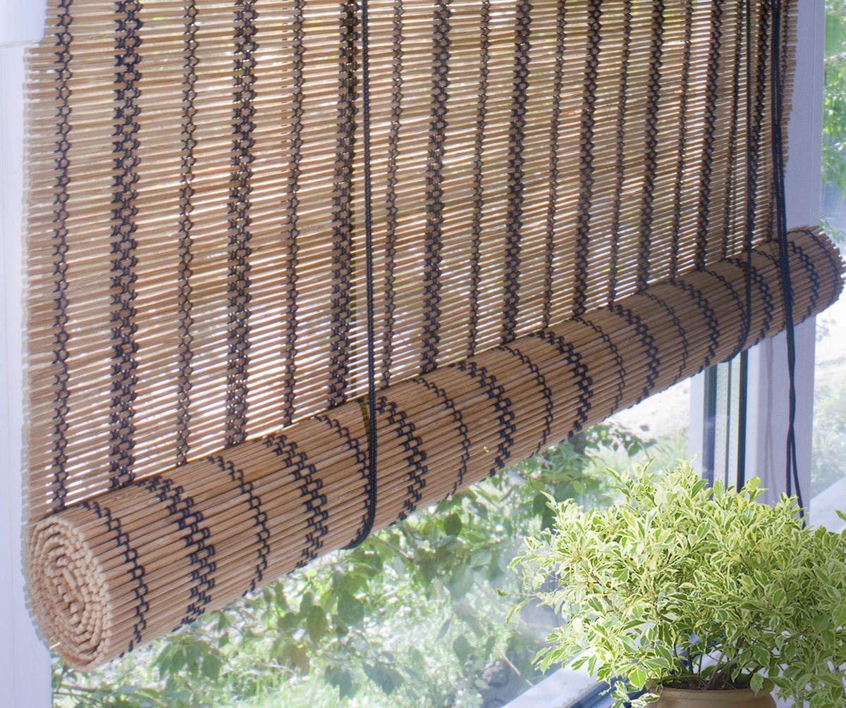 Штора рулонная Эскар Бамбук, цвет: охра, ширина 160 см, высота 160 см70143160160При оформлении интерьера современных помещений многие отдают предпочтение природным материалам. Бамбуковые рулонные шторы - одно из натуральных изделий, способное сделать атмосферу помещения более уютной и в то же время необычной. Свойства бамбука уникальны: он экологически чист, так как быстро вырастает, благодаря чему не успевает накопить вредные вещества из окружающей среды. Кроме того, растение обладает противомикробным и антибактериальным действием. Занавеси из бамбука безопасно использовать в помещениях, где находятся новорожденные дети и люди, склонные к аллергии. Они незаменимы для тех, кто заботится о своем здоровье и уделяет внимание высокому уровню жизни. Бамбуковые рулонные шторы представляют собой полотно, состоящее из тонких бамбуковых стеблей и сворачиваемое в рулон. Римские бамбуковые шторы, как и тканевые римские шторы, при поднятии образуют крупные складки, которые прекрасно декорируют окно. Особенность устройства полотна позволяет свободно пропускать...