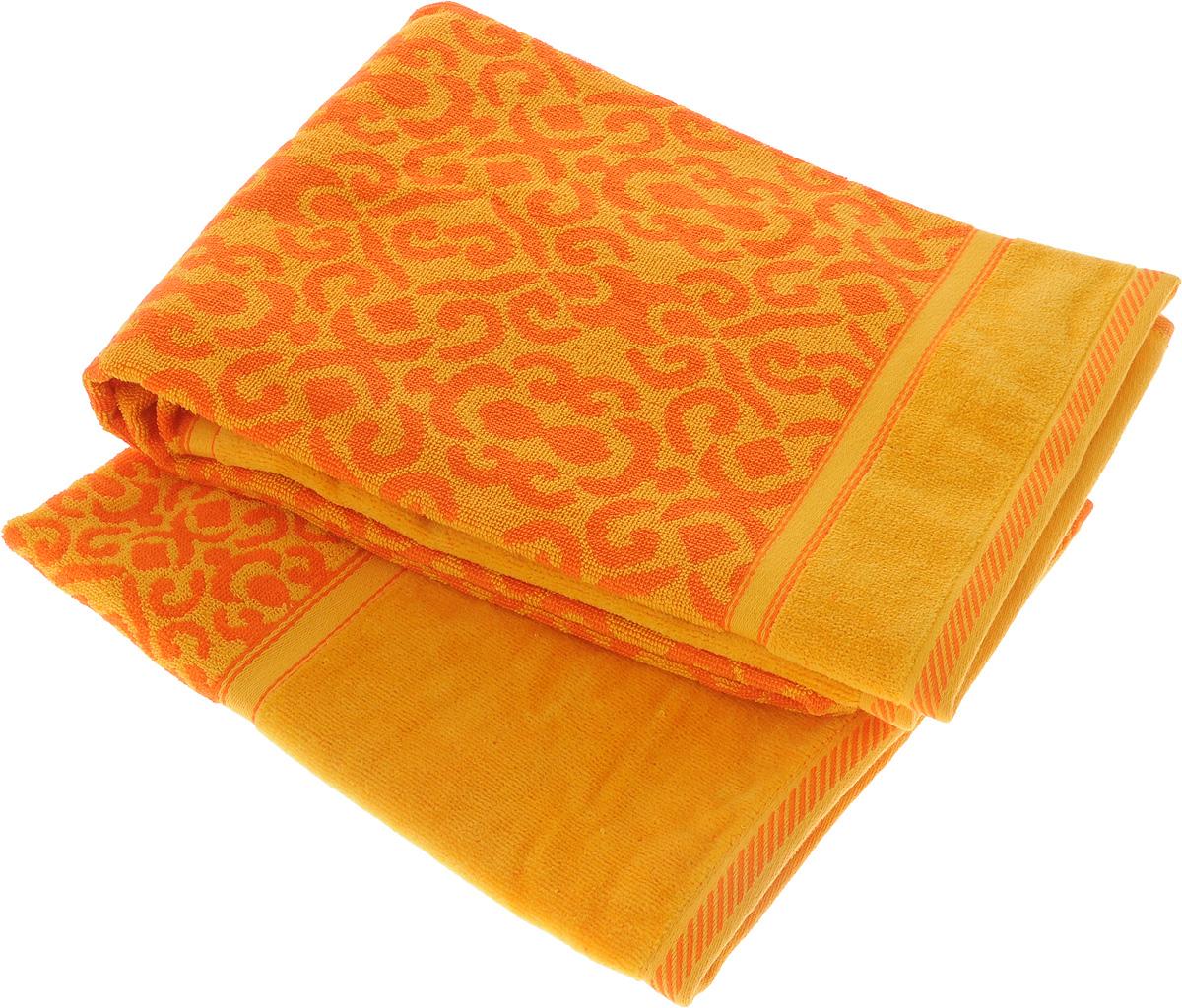Набор махровых полотенец Toalla Флора, цвет: желтый, оранжевый, 2 шт92715461Набор Toalla Флора состоит из 2 прямоугольных махровых полотенец, выполненных из 100% хлопка. Ткань полотенец обладает высокой плотностью и мягкостью, отличается высоким качеством и длительным сроком службы. В процессе эксплуатации материал становится только мягче и приятней на ощупь. Египетский хлопок не содержит линта (хлопковый пух), поэтому на ткани не образуются катышки даже после многократных стирок и длительного использования. Сверхдлинные волокна придают ткани характерный красивый блеск. Полотенца отлично впитывают влагу и быстро сохнут. Такой набор красиво дополнит интерьер ванной комнаты и станет практичным приобретением. Полотенца оформлены изысканными узорами.