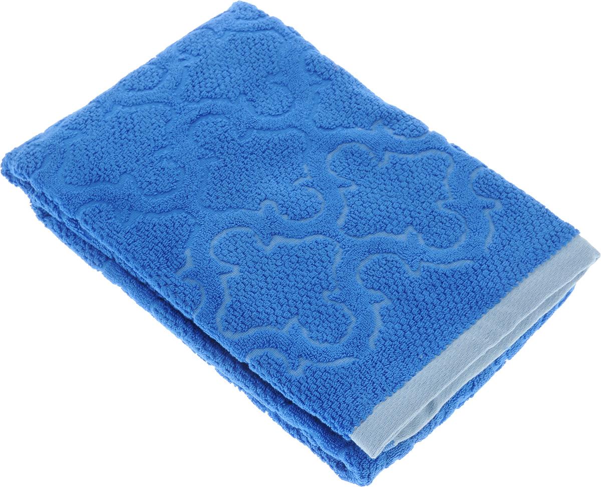 Полотенце махровое Toalla Лагуна, цвет: синий, 70 x 140 см9121796Полотенце махровое Toalla Лагуна выполнено из 100% натурального египетского хлопка. Изделие оформлено изысканным рельефным орнаментом. Ткань полотенца обладает высокой плотностью и мягкостью, отличается высоким качеством и длительным сроком службы. В процессе эксплуатации материал становится только мягче и приятней на ощупь. Египетский хлопок не содержит линта (хлопковый пух), поэтому на ткани не образуются катышки даже после многократных стирок и длительного использования. Сверхдлинные волокна придают ткани характерный красивый блеск. Полотенце отлично впитывает влагу и быстро сохнет. Такое полотенце красиво дополнит интерьер ванной комнаты и станет практичным приобретением.