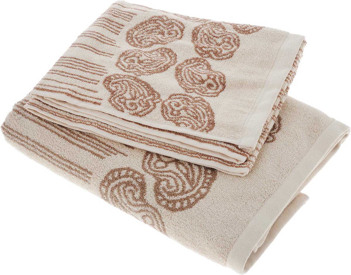 Набор махровых полотенец Toalla Аква, цвет: песочный, коричневый, 2 шт90003201Набор Toalla Аква состоит из 2 прямоугольных махровых полотенец, выполненных из 100% хлопка. Ткань полотенец обладает высокой плотностью и мягкостью, отличается высоким качеством и длительным сроком службы. В процессе эксплуатации материал становится только мягче и приятней на ощупь. Египетский хлопок не содержит линта (хлопковый пух), поэтому на ткани не образуются катышки даже после многократных стирок и длительного использования. Сверхдлинные волокна придают ткани характерный красивый блеск. Полотенца отлично впитывают влагу и быстро сохнут. Такой набор красиво дополнит интерьер ванной комнаты и станет практичным приобретением. Полотенца оформлены изысканными узорами и принтом в полоску.