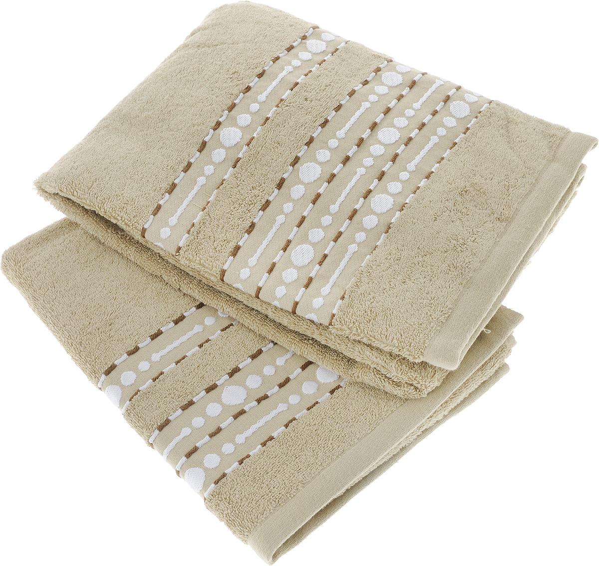 Набор махровых полотенец Toalla Волна, цвет: бежевый, 2 шт92717431Набор Toalla Волна состоит из 2 прямоугольных махровых полотенец, выполненных из 100% хлопка. Ткань полотенец обладает высокой плотностью и мягкостью, отличается высоким качеством и длительным сроком службы. В процессе эксплуатации материал становится только мягче и приятней на ощупь. Египетский хлопок не содержит линта (хлопковый пух), поэтому на ткани не образуются катышки даже после многократных стирок и длительного использования. Сверхдлинные волокна придают ткани характерный красивый блеск. Полотенца отлично впитывают влагу и быстро сохнут. Такой набор красиво дополнит интерьер ванной комнаты и станет практичным приобретением. Полотенца оформлены изящным вышитым бордюром.