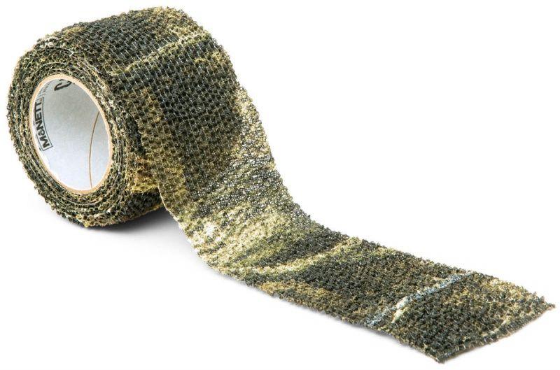 Камуфляжная лента McNett Stretch, цвет: Realtree Xtra19310Камуфляжная лента многоразовая McNett Stretch, цвет - Realtree Xtra. Арт. 19310 Применяется для защиты и маскировки ружей, оптических прицелов, биноклей, фонарей, ножей, фляг и другого снаряжения. Использование ленты позволяет избежать солнечных бликов от оружия, маскирует его, а также защищает от влаги, пыли, механических повреждений, царапин. Уменьшает шум при использовании и вероятность соскальзывания руки. Защищает руки от горячих и холодных поверхностей. Пропитанная латексом, эластичная тканая лента прилипает ко всем поверхностям, прекрасно обтекая их. Прочный и тянущийся материал принимает любую форму, всегда оставаясь на месте. Лента без клейкой основы: при необходимости легко снимается, не оставляет липких следов. Лента может быть использована повторно, что позволяет менять окраску камуфлируемых предметов в зависимости от времени года и вида местности. Не теряет своих свойств в воде и при низких температурах. В экстренных случаях может заменить эластичный...