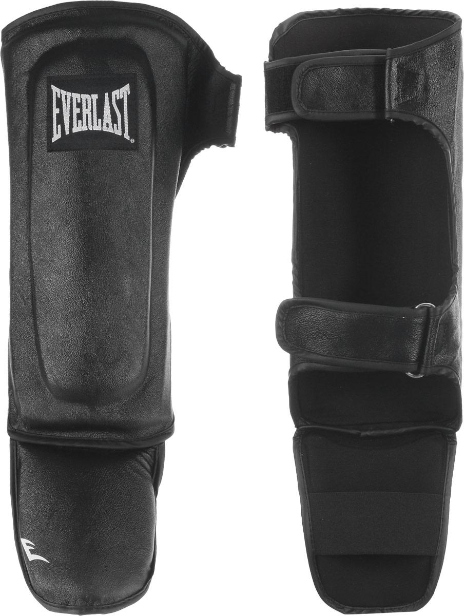 Защита голени и стопы Everlast Martial Arts Leather Shin-Instep, цвет: черный, белый. Размер S/M7750SMUEverlast Martial Arts Leather Shin-Instep - это надежная защита для голени и стопы. Верх выполнен из натуральной кожи. Защита закрепляется на ноге при помощи ремней на липучках. Двойной защитный слой обеспечивает комфорт и надежную защиту от травм и ушибов. Идеально подходит для работы в спаррингах.