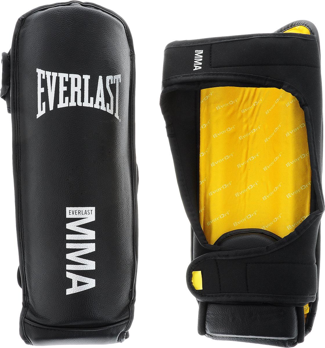 Защита голени и стопы Everlast Grappling, цвет: черный, светло-серый. Размер S/M7950SMUЗащита голени и стопы Everlast Grappling спроектирована специально для ММА. Верх выполнен из высококачественной натуральной кожи. Акцентированное расположение пенного наполнителя обеспечивает отличную защиту. Закрепляется на ноге при помощи ремня на липучке.