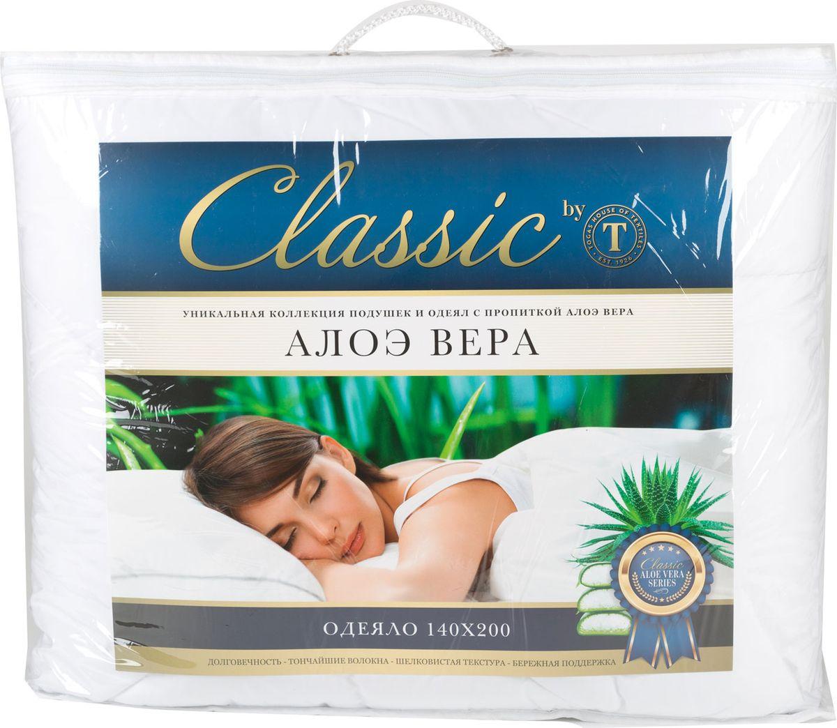 Одеяло Classic by Togas Алоэ вера, наполнитель: синтетический пух, 140 х 200 см42.431Одеяло Classic by Togas Алоэ вера поможет расслабиться, снимет усталость и подарит вам спокойный и здоровый сон. Одеяло с синтетическим наполнителем необычайно легкое, пышное, обладает превосходными теплозащитными свойствами. Такой наполнитель отлично удерживает воздух и тепло, превосходно впитывает влагу и испаряет ее. Это экологически чистый материал с высокими гигиеническими и гипоаллергенными качествами, который к тому же очень практичен. Одеяло с таким наполнителем можно стирать дома, а сохнет оно почти моментально. Чехол одеяла сделан из высокотехнологичной ткани - микрофибры. Она приятна на ощупь и отличается высокой прочностью. Гель алоэ вера, которым пропитаны чехол и наполнитель, обладает уникальными свойствами: оказывает оздоравливающий и тонизирующий эффект, увлажняет кожу, способствует улучшению работы сердца, расслабляет и снимает напряжение в мышцах.