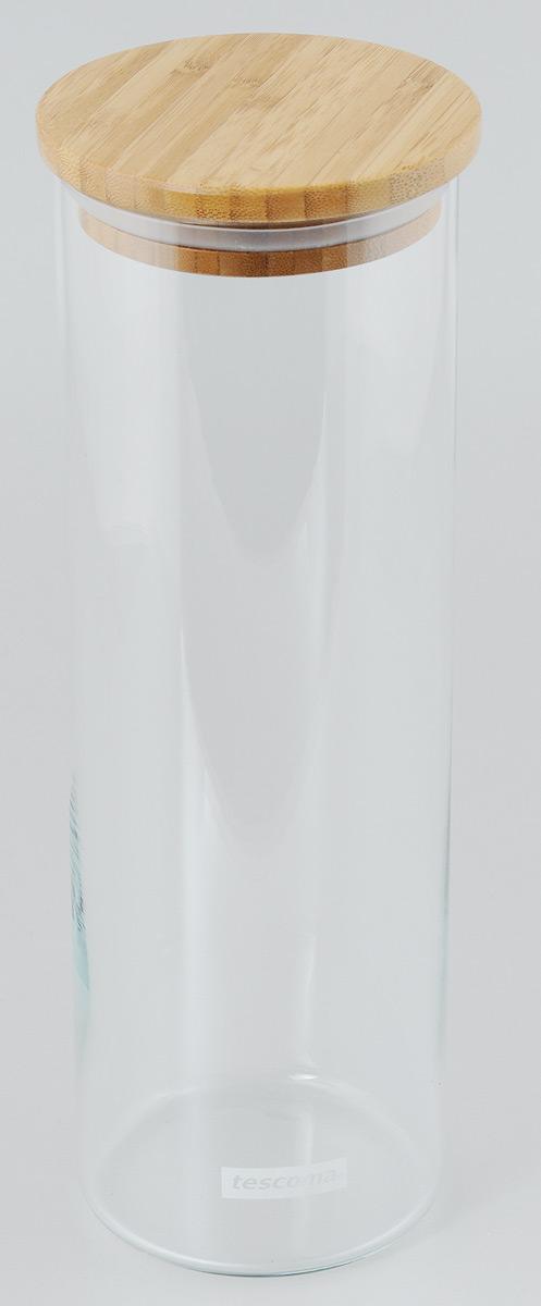 Банка для сыпучих продуктов Tescoma Fiesta, цвет: прозрачный, дерево, 1,8 л894626Банка для сыпучих продуктов Tescoma Fiesta, изготовленная из прочного боросиликатного стекла, позволит вам хранить разнообразные сыпучие продукты, такие как кофе, крупы, сахар, соль или специи. Емкость оснащена плотно прилегающей крышкой, изготовленной из дерева и снабженная силиконовой прокладкой. Банка для сыпучих продуктов станет незаменимым помощником на кухне. Можно мыть в посудомоечной машине, крышку - нельзя. Диаметр по верхнему краю: 9 см. Диаметр дна: 9 см. Высота без учета крышки: 29 см. Высота с учетом крышки: 30 см. Объем: 1,8 л.