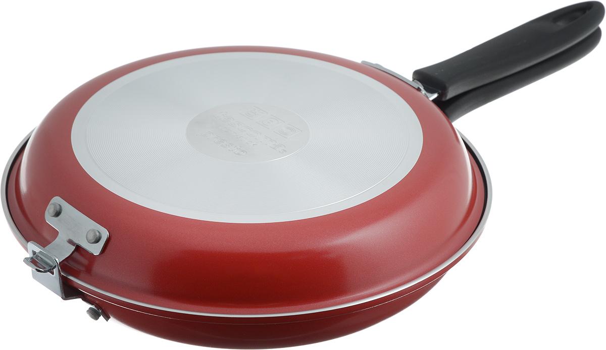 Сковорода двухсторонняя Tescoma Presto, цвет: красный, стальной, диаметр 26 см. 594346594346_красныйВысококачественная сковорода Tescoma Presto состоящая из двух частей, изготовлена из высококачественной нержавеющей стали с антипригарным покрытием. Сковорода идеальна для легкой и быстрой двухсторонней жарки и тушения продуктов. Прекрасно подходит для приготовления высоких омлетов типа тортилья, фриттата, фаршированных карманов, овощных и рисовых блюд и так далее. Снабжена ненагревающейся ручкой. Изделие можно использовать как две отдельные классические сковородки. В комплекте предоставлена брошюра с рецептами. Подходит для электрических, газовых и стеклокерамических плит. Можно мыть в посудомоечной машине. Диаметр нижней сковороды: 26 см. Диаметр верхней сковороды: 25 см.